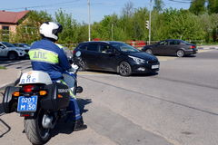 The inspector of motorized units road policing controls the highway. Stock Image