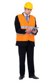 An inspector ready to work. An inspector inspecting a building site Royalty Free Stock Photo