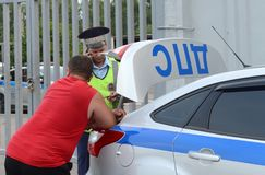 An inspector of the road police patrol service makes a report on the violation of traffic rules. MOSCOW REGION, RUSSIA - AUGUST 3,2017:An inspector of the road Royalty Free Stock Photography