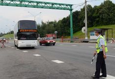 The inspector of the road police patrol stops the intercity bus for checking. Moscow Region, Russia - August 3,2017: The inspector of the road police patrol Stock Image