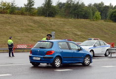 The inspector of traffic police check the documents of the driver on the track `Don`. Stock Photo
