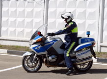 The inspector of traffic police motorcycle BMW leaves to patrol the roads. Stock Photography