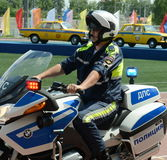 The inspector of traffic police motorcycle BMW leaves to patrol the roads. Stock Photos