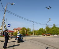 The inspector of traffic police services monitors the route using the quadcopter. Royalty Free Stock Photos