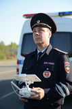 The inspector of traffic police services monitors the route using the quadcopter. Stock Photos