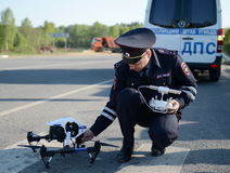 The inspector of traffic police services monitors the route using the quadcopter. Royalty Free Stock Photography
