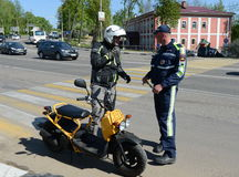 The inspector of traffic police stopped to check the motorcyclist. Royalty Free Stock Photo
