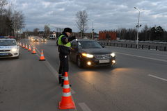 The inspector of traffic police stops the car. Royalty Free Stock Photography
