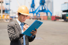 Inspector at work. Close-up of a seaport inspector at work Stock Photos
