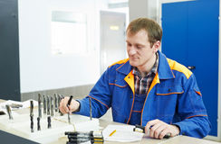 Inspector worker at factory manufacturing. Mechanical technician inspector worker checking details at manufacturing tool workshop royalty free stock photo
