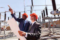Inspectors electrical substation. Two inspectors working together in electrical substation Stock Photography