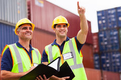 Inspectors inspection container. Two inspectors doing inspection at the harbor container yard Royalty Free Stock Images