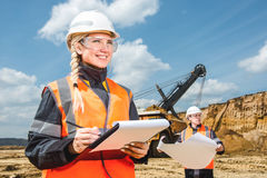 Inspectors in an open pit. Woman and a men working on a project in an open pit Stock Images
