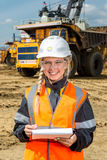 Inspectors in an open pit. Woman working on a project in an open pit Stock Photos