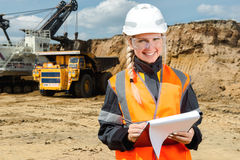 Inspectors in an open pit. Woman working on a project in an open pit Stock Photography