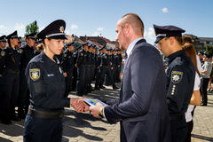 Inspectors patrol police handed the officer ranks in Uzhgorod. Uzhgorod, Ukraine - August 25. 2016: The ceremony of awarding titles to inspectors of police Royalty Free Stock Photo