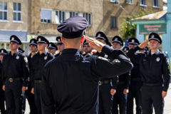 Inspectors patrol police handed the officer ranks in Uzhgorod. Uzhgorod, Ukraine - August 25. 2016: Policemans during the ceremony of awarding titles to Royalty Free Stock Photos