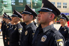 Inspectors patrol police handed the officer ranks in Uzhgorod. Uzhgorod, Ukraine - August 25. 2016: Policemans during the ceremony of awarding titles to Stock Photos