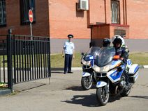Inspectors of traffic police on motorcycles go on patrolling roads. MYTISHCHI, RUSSIA - AUGUST 12, 2017: Inspectors of traffic police on motorcycles go on Royalty Free Stock Image