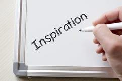 Inspiratie op whiteboard wordt geschreven die royalty-vrije stock fotografie