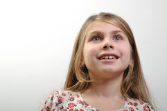Inspiration. Attractive young girl with inspiration facial expression looking up Stock Images