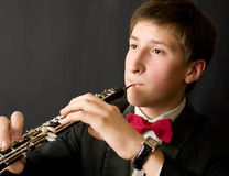 Inspiration. Portrait of the young musician on a dark background Stock Image