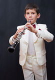 Inspiration. Portrait of the young musician on a dark background Stock Images