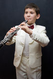Inspiration. Portrait of the young musician on a dark background Royalty Free Stock Photography