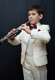 Inspiration. Portrait of the young musician on a dark background Stock Photo