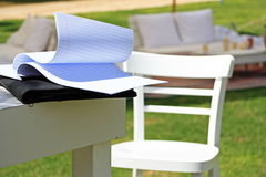 Inspiration. White wooden table, paper and chair on the open air Stock Photo