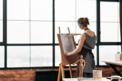 Inspiration artist drawing conceptual mannequin. Inspiration and encouragement. Conceptual articulated mannequin pointing at role model talented artist drawing stock image