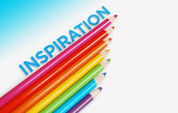 Inspiration background concept. Multicolor pencils and inspiration word with copy space Royalty Free Stock Photography