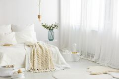 Inspiration to decorate basic bedroom. Inspiration for a basic white bedroom interior with textiles and diy designer accessories Royalty Free Stock Image