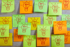 Inspiration concept  light bulb idea on colorful sticky note pad Stock Images