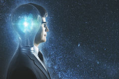 Inspiration concept. Side portrait of abstract lamp headed businessman in space. Inspiration concept. Double exposure Royalty Free Stock Image