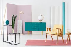 Blue sideboard and industrial tables. Inspiration for a designer living room interior color scheme with a modern, turquoise blue sideboard and industrial, marble Royalty Free Stock Images