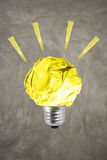 Inspiration environment concept crumpled yellow paper light bulb royalty free stock images