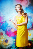 Inspiration. Fashion shot of a beautiful model posing on a background of bright large flowers. Beauty, fashion. Summer inspiration Stock Image