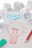Inspiration and ideas with bulb. Symbol on. Bulb on drawing as a symbol of new ideas Stock Photography
