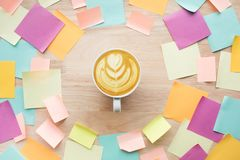 Inspiration ideas concepts with coffee cup and colorful notepaper. On wood table.nobody Stock Images
