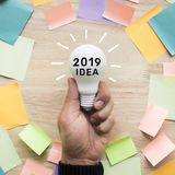 2019 Inspiration ideas concepts with hand holding white lightbulb Stock Images