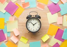 Inspiration ideas concepts with watch and colorful notepaper. On wood table.nobody Stock Photos