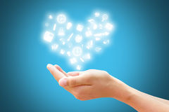 Inspiration of Learning. And Education concept, Hand with knowledge icon decorate to heart symbol with blue background Stock Images