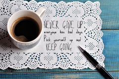 Inspiration motivation quotation  Never give up and keep going and cup of coffee Success concept Stock Image