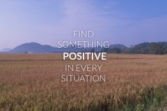 Inspiration and motivation quote on blurred rice field backgroun. D...find something positive in every situation royalty free stock image