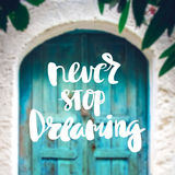 Inspiration and motivation quotes. Motivational Quote on purple color background never stop dreaming stock photos