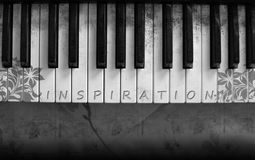 Inspiration Music. A keyboard with the word inspiration on the keys Royalty Free Stock Photo