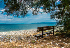 Inspiration place. Beach. Sea. Bench by the sea is a place where you can look for inspiration for something good, the beautiful, magical. Also, this may be the Stock Images