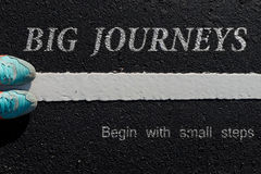 Inspiration quote :  Big journeys begin with small steps  on a Stock Photo
