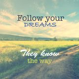 Quotation on vintage field. Inspiration quote Follow your dreams They know the way on vintage photo, blurry field and dirt road Royalty Free Stock Images
